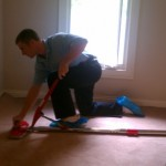Restretching an Atlanta Carpet using professional tools.